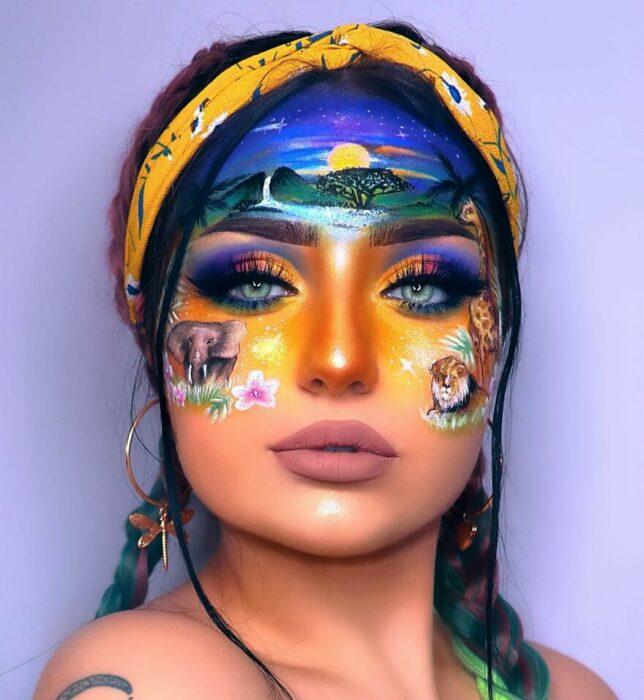 Chica con el rostro pintado con un paisaje