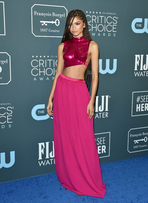 Zendaya wearing a fuchsia skirt with a bright pink armor style top