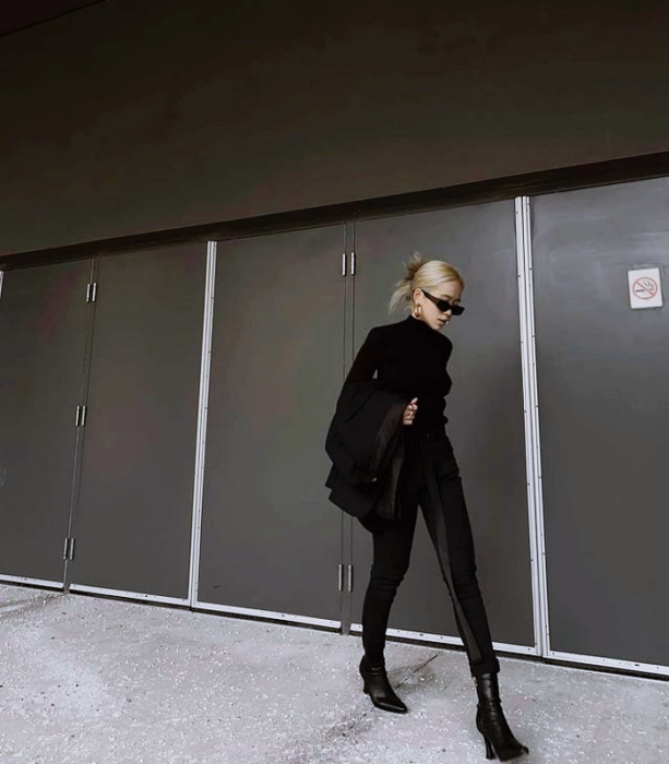 blonde girl with sunglasses, long sleeve black blouse, black skinny jeans, black ankle boots, black jackets