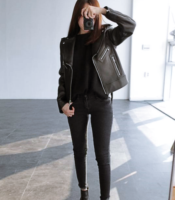 long brown hair girl wearing black top, black leather jacket, black denim skinny jeans, black ankle boots