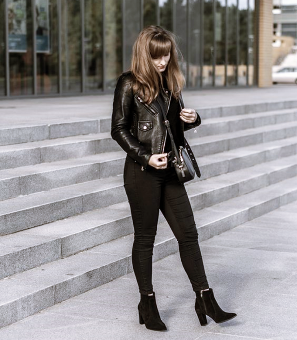 dark long hair girl wearing black top, leather jacket, black skinny jeans, black high heel ankle boots