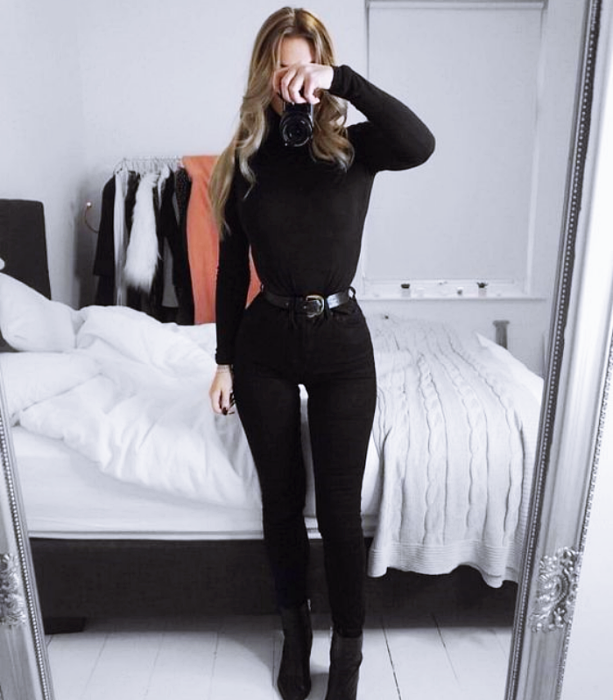 long light hair girl wearing black high neck top, long sleeves, black skinny jeans, ankle boots