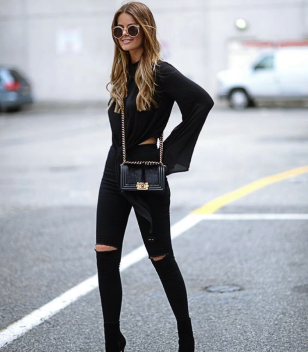 light long hair girl wearing sunglasses, long sleeve black blouse, black skinny jeans, black high heel ankle boots