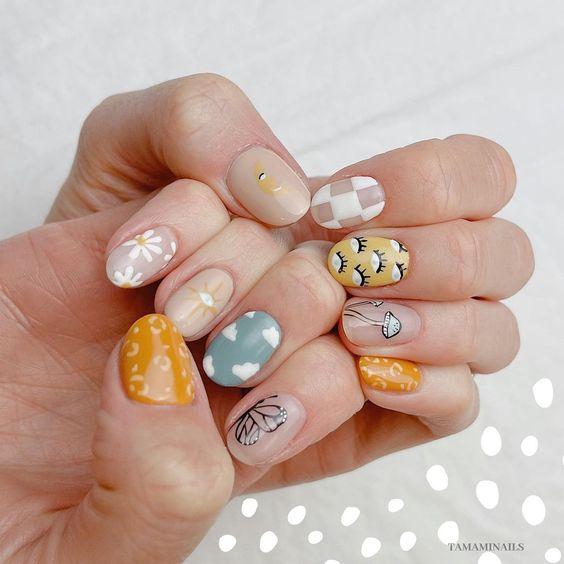 manicuras con tonos pastel, nubes y ojos ;13 Manicuras para sumarte a la tendencia 'pic and mix'