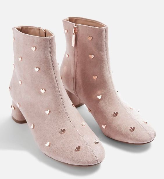 Pastel pink ankle boots with heart-shaped stud decoration; Studded ankle boots for badass girls