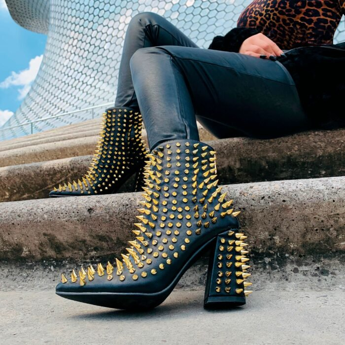 High ankle boots with studs applications in a peak in golden color; Studded ankle boots for badass girls