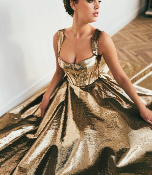 Girl wearing a gold colored dress