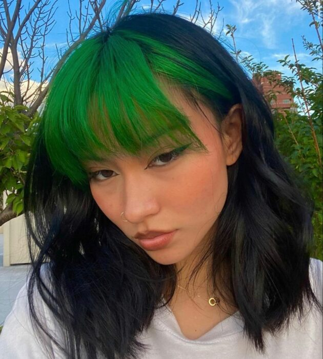 Girl with dyed green hair
