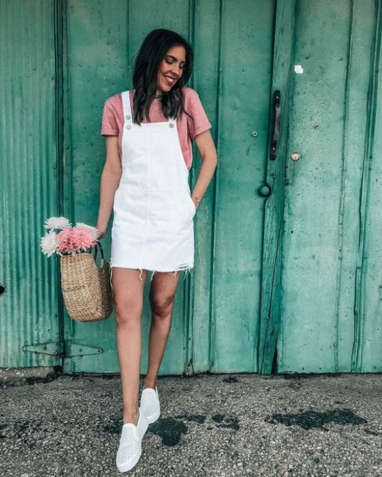 Girl wearing overalls with a pink blouse