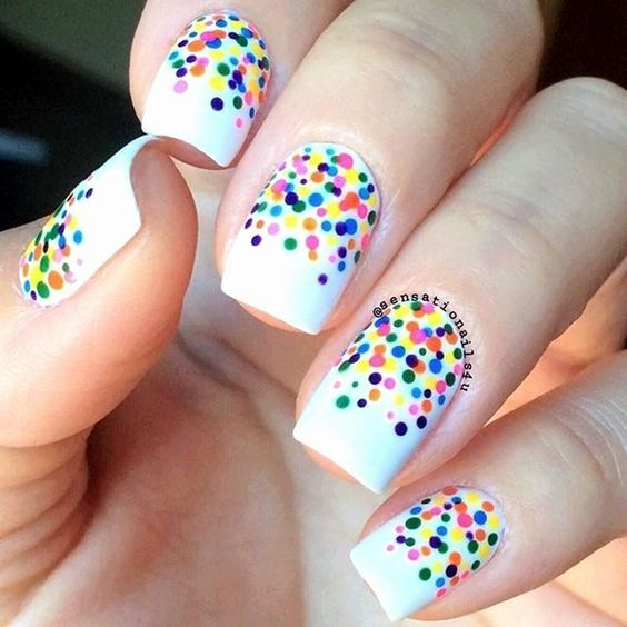 White manicure with colored dots; Manicures with colored dots