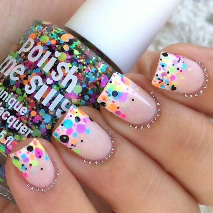 Manicure in pale pink tone with fluorescent points; Manicures with colored dots