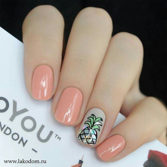 Manicure in pink with a pineapple decoration in the center