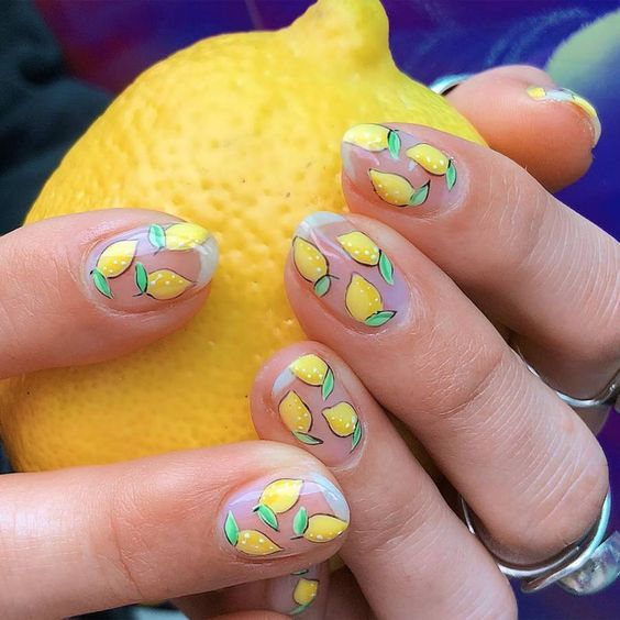 Glass manicure decorated with green lemons