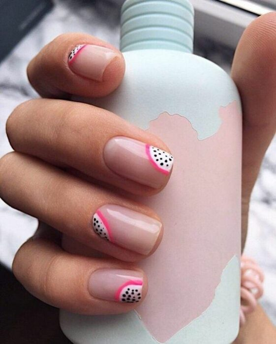 Manicure in pastel pink background with dragon fruit decoration; Fruity manicures to spice up your spring