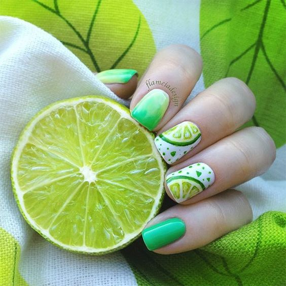 Manicure in green tone decorated with slices of lemons; Fruity manicures to spice up your spring