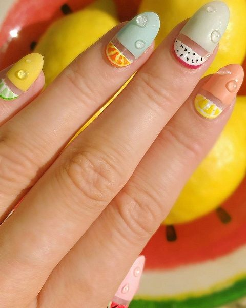 Manicure decorated with half fruits; Fruity manicures to spice up your spring