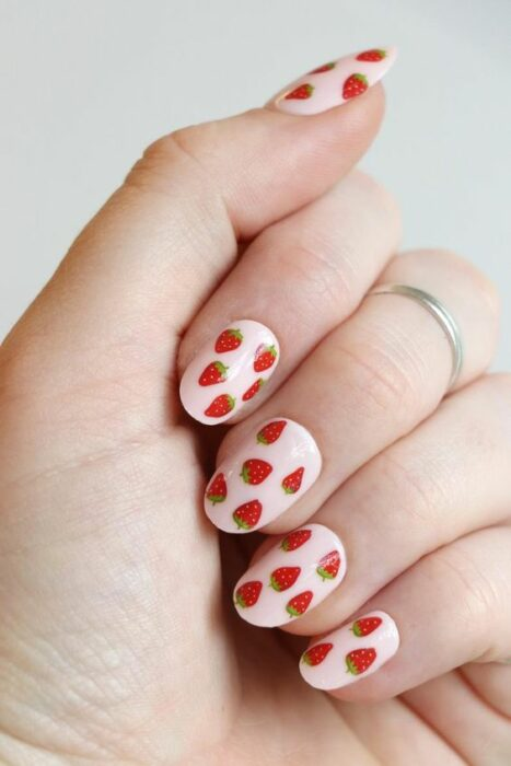 Manicure in pastel pink tone decorated with strawberries; Fruity manicures to spice up your spring