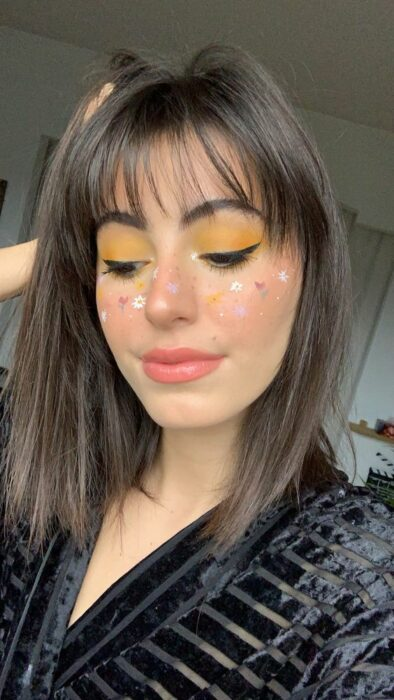 girl with makeup in yellow tone and miniature flowers; Spring makeup you'll love
