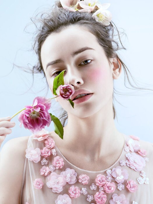 girl holding a rose with semi natural makeup; Spring makeup you'll love