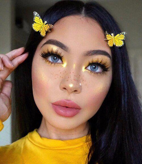 Chica con maquillaje amarillo y mariposas a los costados; Maquillaje de primavera que amarás