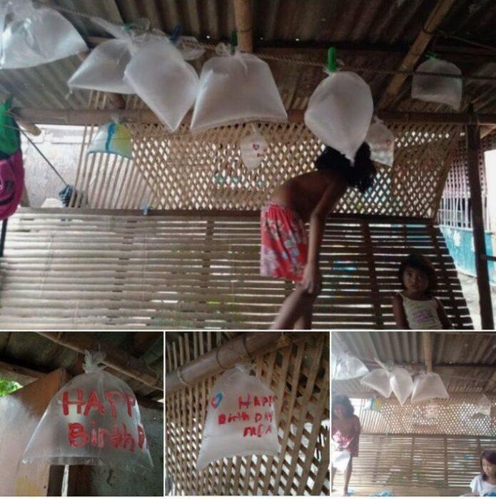 niños decorando una casa con bolsas de plástico como si fueran globos; Niños de bajos recursos usan bolsas de plástico como globos para celebrar el cumpleaños de su papá