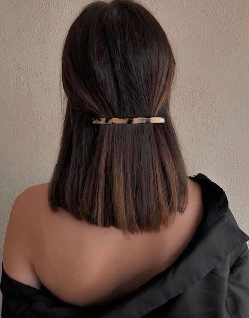 Girl with shoulder length hair fastened with a long barrette