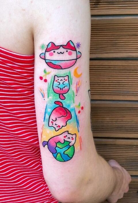Kittens getting out of a spaceship tattoo; Tattoos to carry mishi always with you
