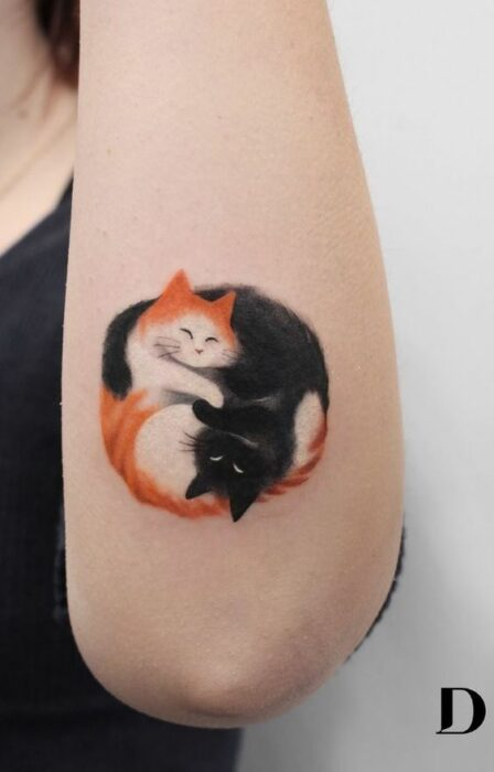 Little egypt tattoo hugging like yin-yang; Tattoos to carry mishi always with you