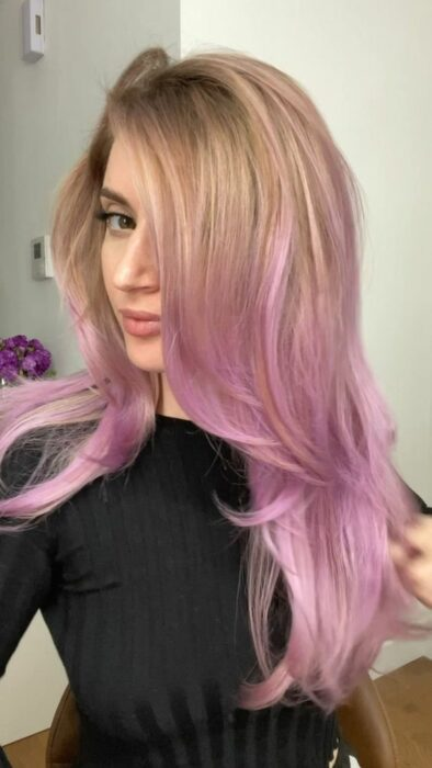 Girl with hair dyed in lilac balayage effect; Pretty pastel dyes you should try