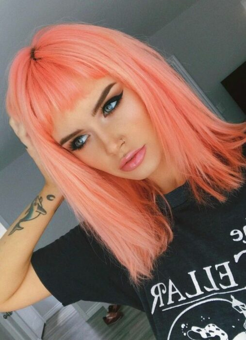 Girl with dyed peach hair; Pretty pastel dyes you should try