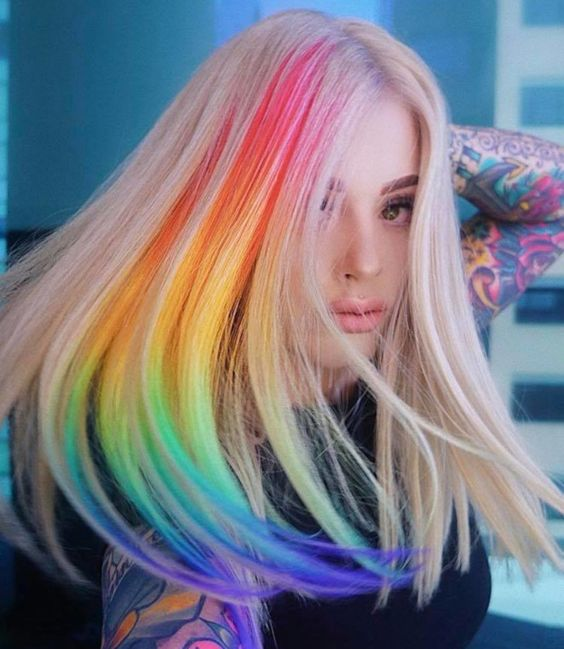 Girl with blonde hair dyed with a rainbow; Pretty pastel dyes you should try