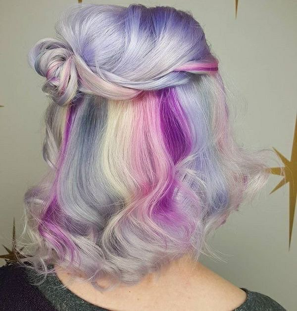 Girl with hair dyed in pastel pink, yellow and lilac tones; Pretty pastel dyes you should try