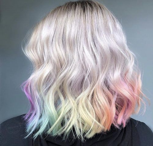 Girl with hair dyed at the ends with a rainbow; Pretty pastel dyes you should try