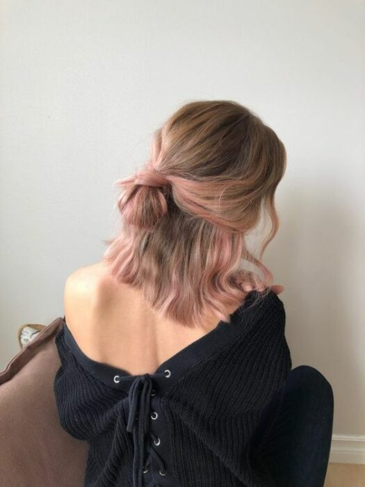 Girl with hair dyed light brown with tips in pastel pink; Pretty pastel dyes you should try