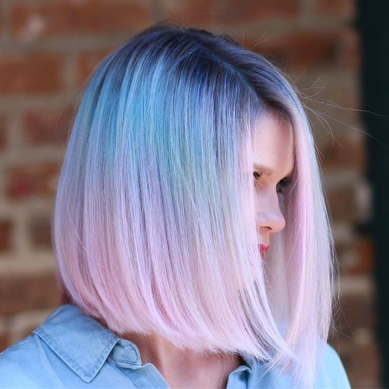 Girl with dyed hair in blue and pink balayage effect; Pretty pastel dyes you should try