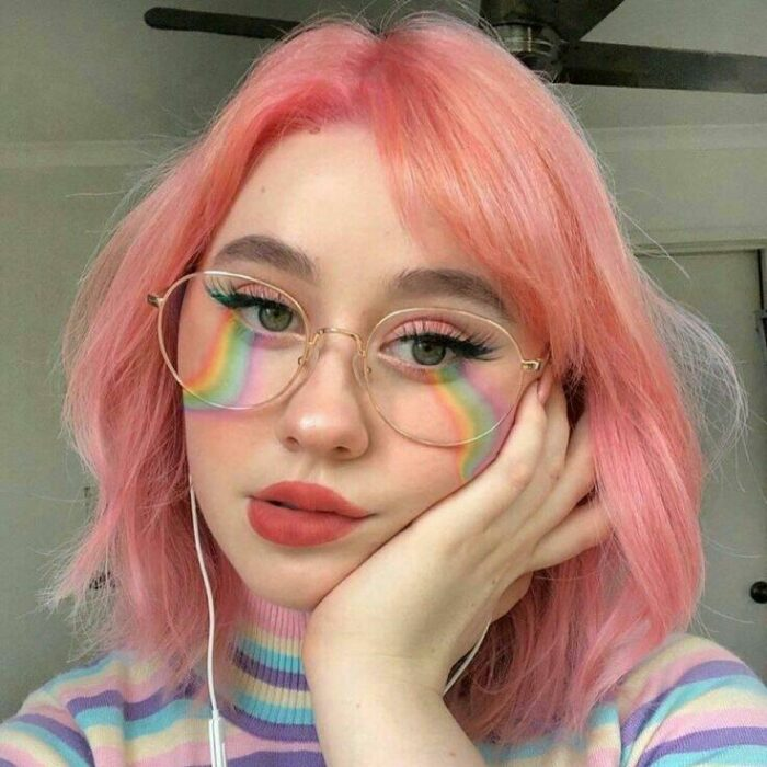 Girl with hair dyed in a mix of peach and pink, Pretty pastel hair dyes you should try