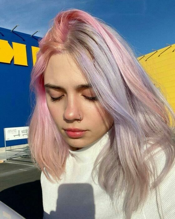 Girl with hair dyed in pastel shades in pink and lilac; Pretty pastel dyes you should try