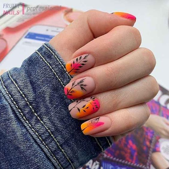 Manicure in tropical tones decorated with leaves in black tone; Pretty nails with leaf design