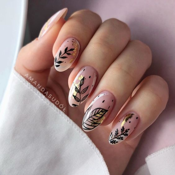 Crystal effect manicure with black leaf decoration; Pretty nails with leaf design