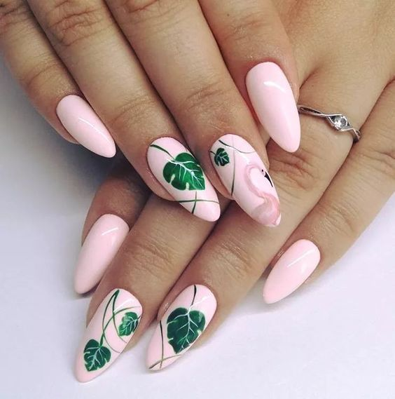 Pastel pink manicure with green leaf decoration; Pretty nails with leaf design