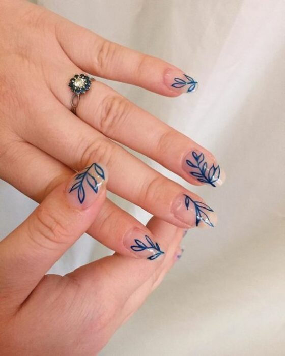 Crystal effect manicure with blue leaf decoration; Pretty nails with leaf design