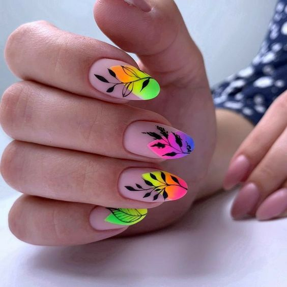 Fluorescent manicure with black leaves; Pretty nails with leaf design
