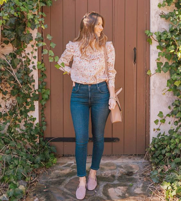 light haired girl wearing pink puff sleeve blouse, skinny jeans, pink fur flats and pink handbag