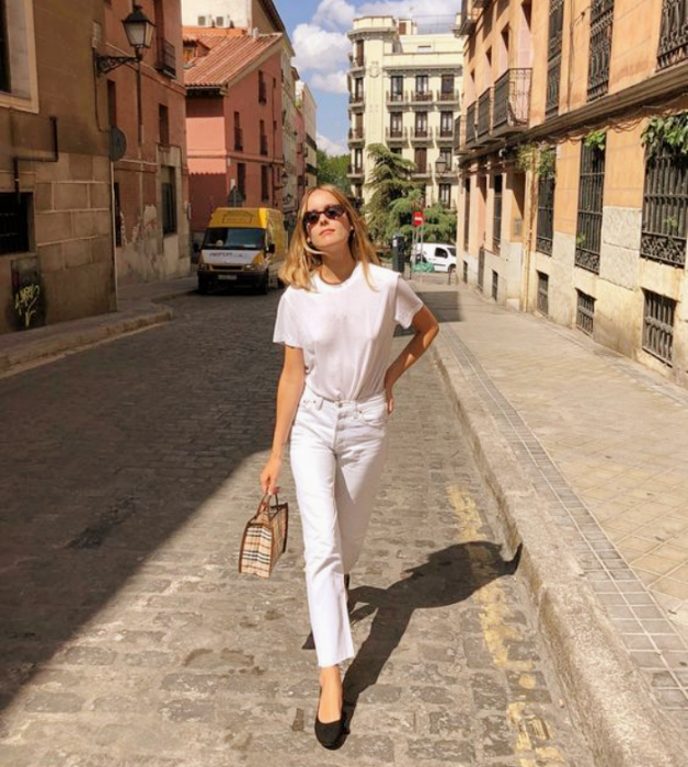 blonde girl in sunglasses, white t-shirt, tight white jeans and black leather flats