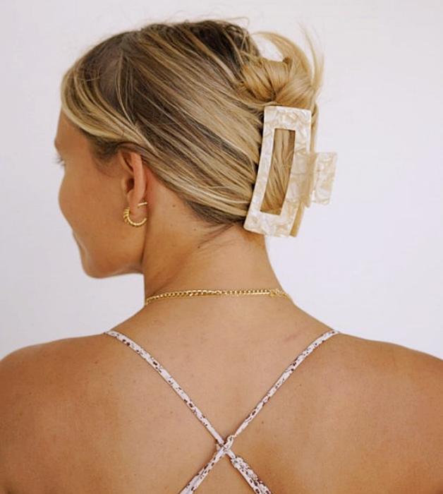 blonde girl with cross straps top, rectangular light beige hair clip