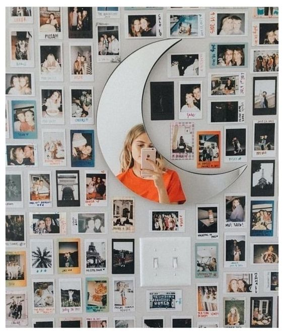 Decoración con fotos instax pegadas a la pared y acompañadas con luces