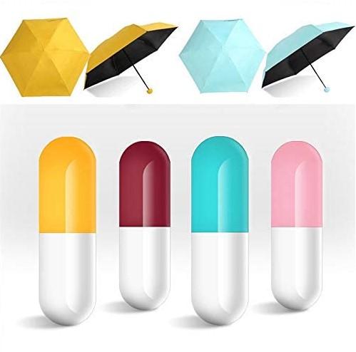 Sombrillas de colores en funda de capsula