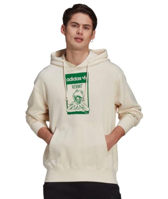 Línea de ropa y calzado de Adidas, Stan Smith Disney; sudadera o hoodie de cuello redondo, con gorro, color hueso y estampado verde de la Rana René