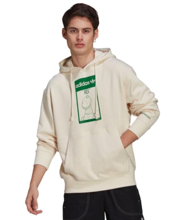 Linea de ropa y calzado de Adidas, Stan Smith Disney; sudadera o hoodie de cuello redondo, con gorro, color hueso y estampado verde de Rex de Toy Story
