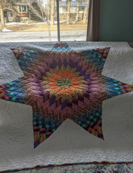 colcha con una estrella decorando el centro